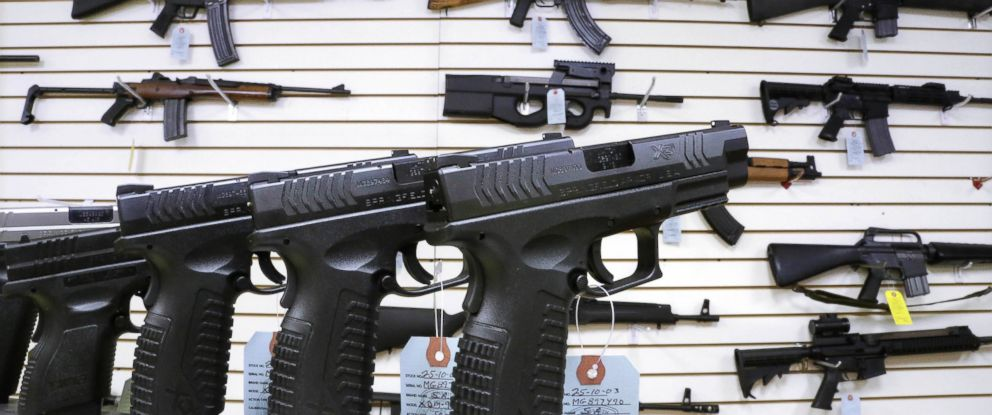 PHOTO: In this Jan. 16, 2013 file photo, assault weapons and hand guns displayed for sale in Springfield, Ill.