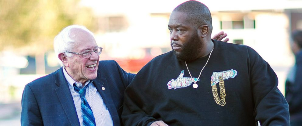 PHOTO: Democratic presidential candidate Sen. Bernie Sanders walks in with rapper Killer Mike for a visit to The Busy Bee Cafe, Nov. 23, 2015, in Atlanta.