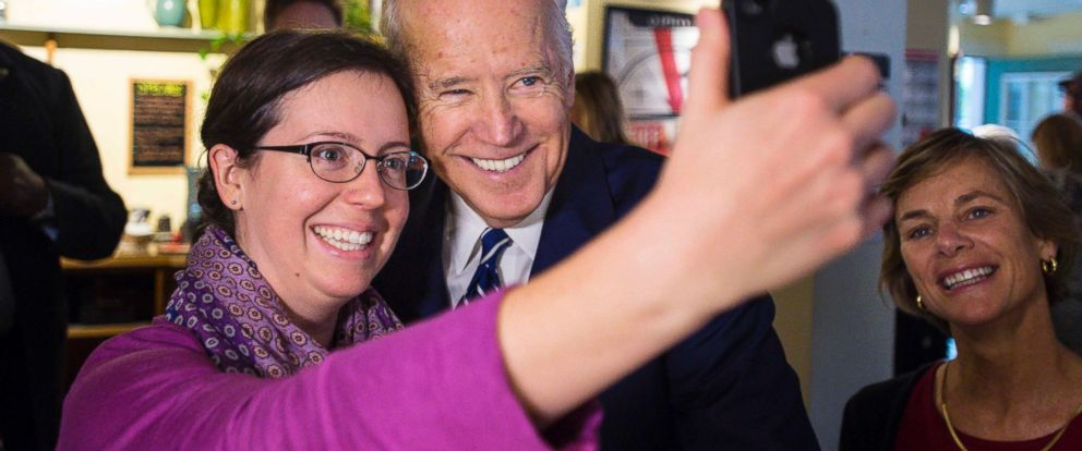 PHOTO: Vice President Joe Biden poses for a selfie with Christina Lauterbach as he greets diners at the Penny Cluse Cafe in Burlington, Vermont, Oct. 21, 2016, before participating in a Cancer Moonshot Roundtable at the University of Vermont.
