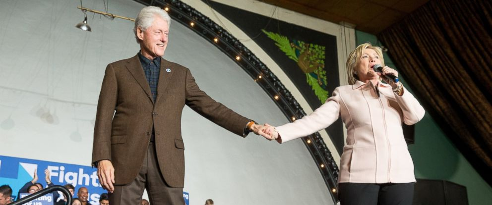 PHOTO: Democratic presidential candidate Hillary Clinton holds hands with her husband former President Bill Clinton as she takes the stage to speak at a rally at the Col Ballroom in Davenport, Iowa, Friday, Jan. 29, 2016.