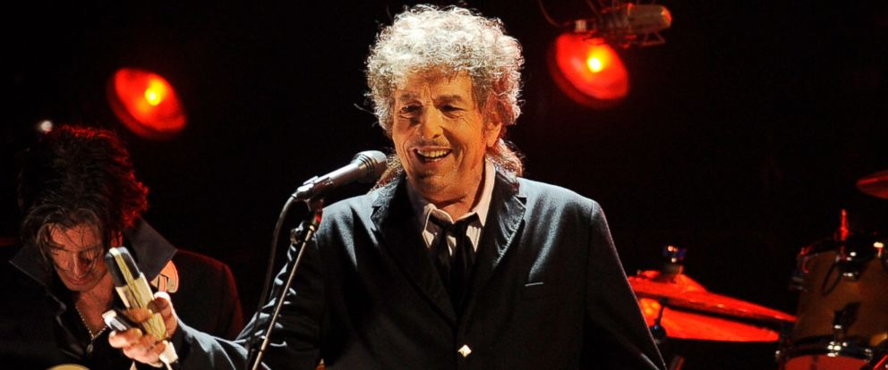 PHOTO: Bob Dylan performs January 12, 2012 in Los Angeles. Dylan, who was named the winner of the 2016 Nobel Prize in literature says he ?absolutely? wants to attend the Nobel Prize Award Ceremony in December.