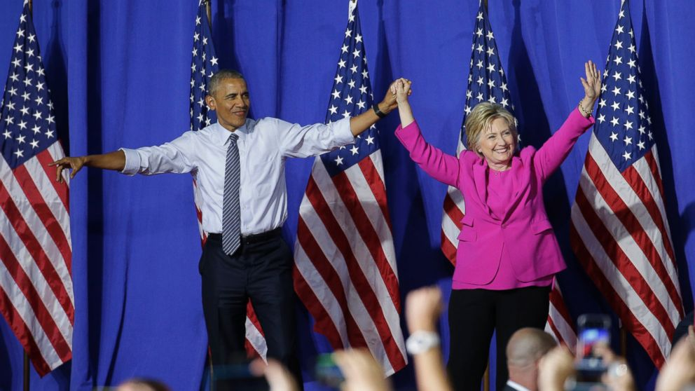 President Barack Obama and Democratic presidential candidate Hillary Clinton wave to the crowd during a campaign rally for Clinton in Charlotte, North Carolina, July 5, 2016.