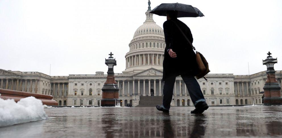 PHOTO: A person walks on Capitol Hill in Washington, Dec. 9, 2013.