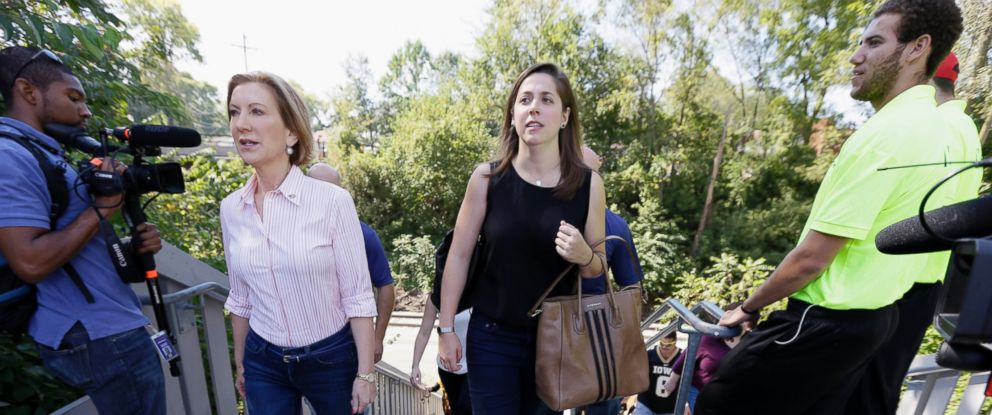 PHOTO: Republican presidential candidate Carly Fiorina walks with her assistant Rebecca Schieber, right, before a University of Iowa football game in Iowa City, Iowa in this Sept. 26, 2015 file photo.