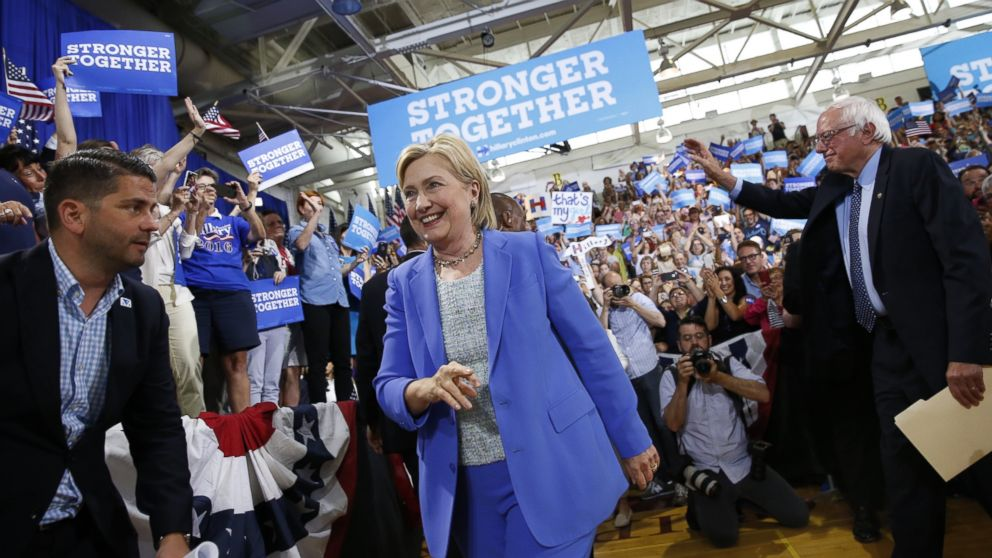 Democratic presidential candidate Hillary Clinton, followed by Sen. Bernie Sanders, I-Vt. arrives for a rally in Portsmouth, N.H., July 12, 2016.