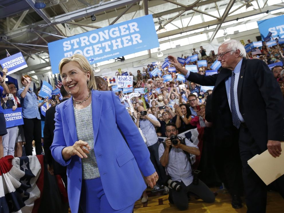 PHOTO: Democratic presidential candidate Hillary Clinton, followed by Sen. Bernie Sanders, I-Vt. arrives for a rally in Portsmouth, N.H., July 12, 2016.