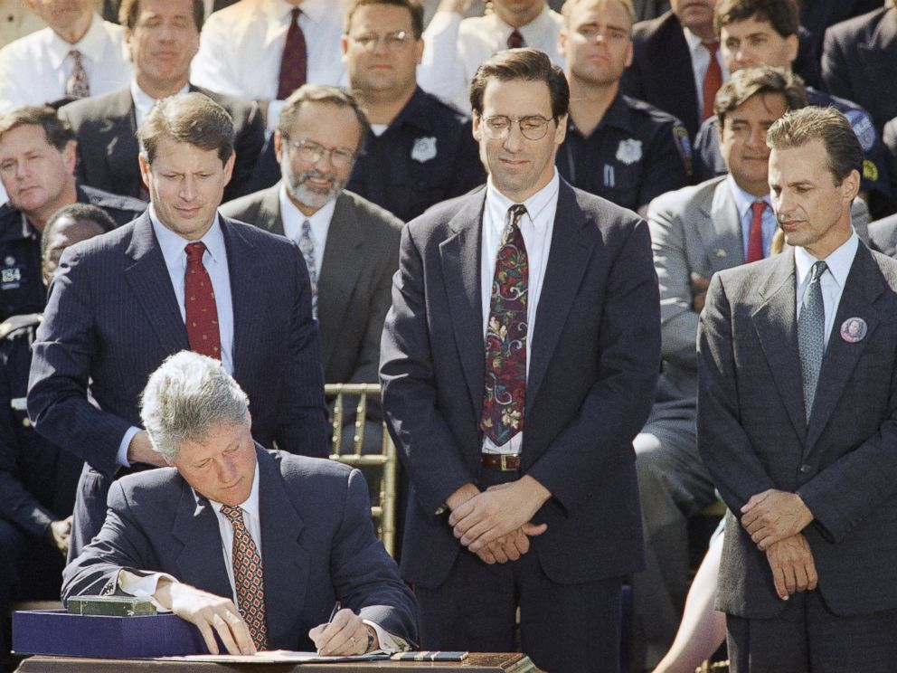 PHOTO: President Bill Clinton signs the $30 billion crime bill during a ceremony on the South Lawn of the White House in Washington on Sept. 13, 1994.