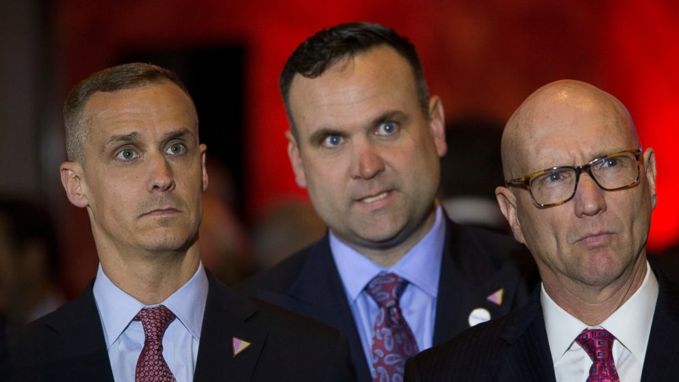 Republican presidential candidate Donald Trump campaign manager Corey Lewandowski, left, Dan Scavino, center, and Michael Glassner, watch as Ted Cruz ends his campaign, ahead of a primary night news conference by Trump, May 3, 2016, in New York City.
