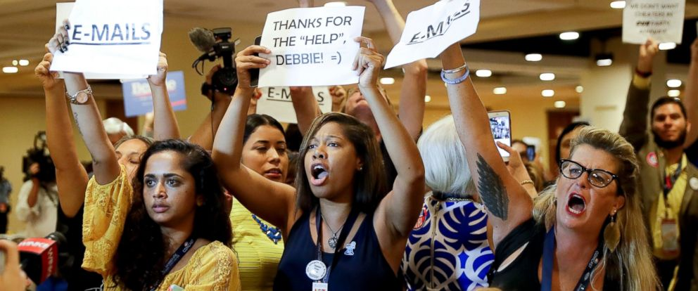 PHOTO: Protesters yell as DNC Chairwoman, Debbie Wasserman Schultz, D-Fla., arrives for a Florida delegation breakfast, July 25, 2016, in Philadelphia, during the first day of the Democratic National Con