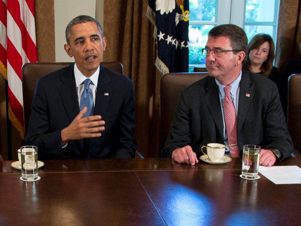 FILE - In this Sept. 30, 2013 file photo, then-Deputy Defense Secretary Ashton Carter, right, listens a President Barack Obama speaks to members of the media in the Cabinet Room of the White House.