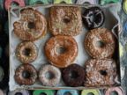 PHOTO: A box with a variety of doughnuts from Doughnut Plant sit in the front window of the shop on New Yorks Lower East Side, Jan. 12, 2007. Doughnut Plant owner Mark Isreal has been making trans-fat-free, all-natural doughnuts for a dozen years.