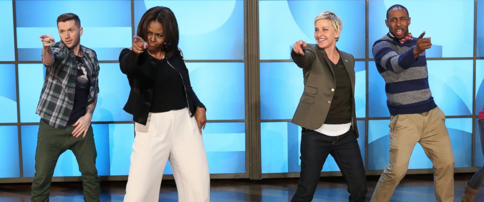 """PHOTO: Talk-show host Ellen DeGeneres dances with first lady Michelle Obama as she takes part in Obamas #GimmeFive Challenge during a taping of """"The Ellen DeGeneres Show"""" March 12, 2015, in Burbank, Calif."""