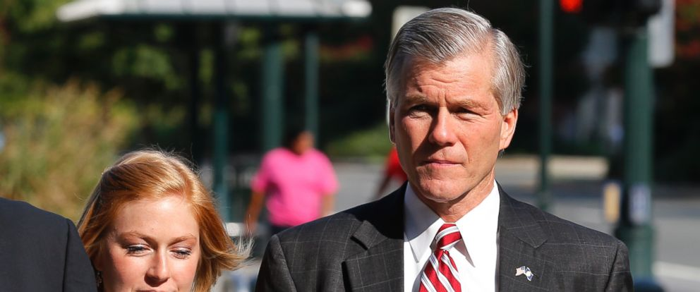 Former Virginia Gov. Bob McDonnell arrives at federal court with his daughter Cailin Young, left, Thursday, Aug. 21, 2014, in Richmond, Va. McDonnell is expected to continue his testimony in his corruption trial on Thursday.