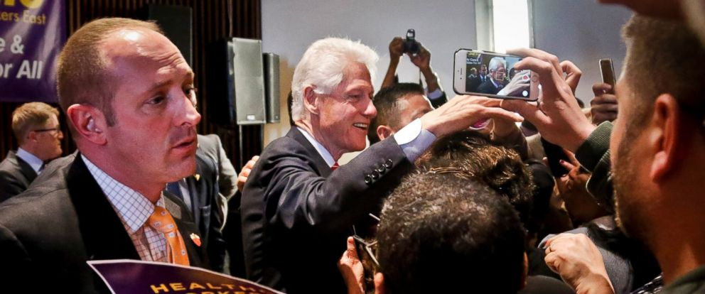 PHOTO: Former President Bill Clinton meet members of the 1199 healthcare union after speaking to the group during a campaign stop for his wife, Democratic presidential candidate Hillary Clinton, March 31, 2016, in New York.