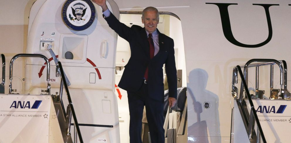 PHOTO: U.S. Vice President Joe Biden waves upon arriving at Tokyo International Airport, Dec. 2, 2013.