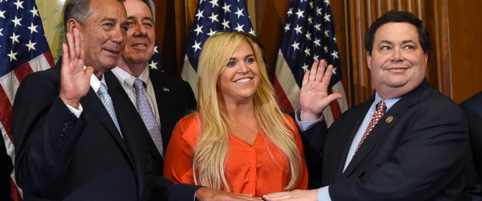 PHOTO: House Speaker John Boehner of Ohio poses for a photo with Rep. Blake Farenthold, right, accompanied by family, to re-enact the House oath-of-office, in this Jan. 6, 2015 file photo on Capitol Hill in Washington.