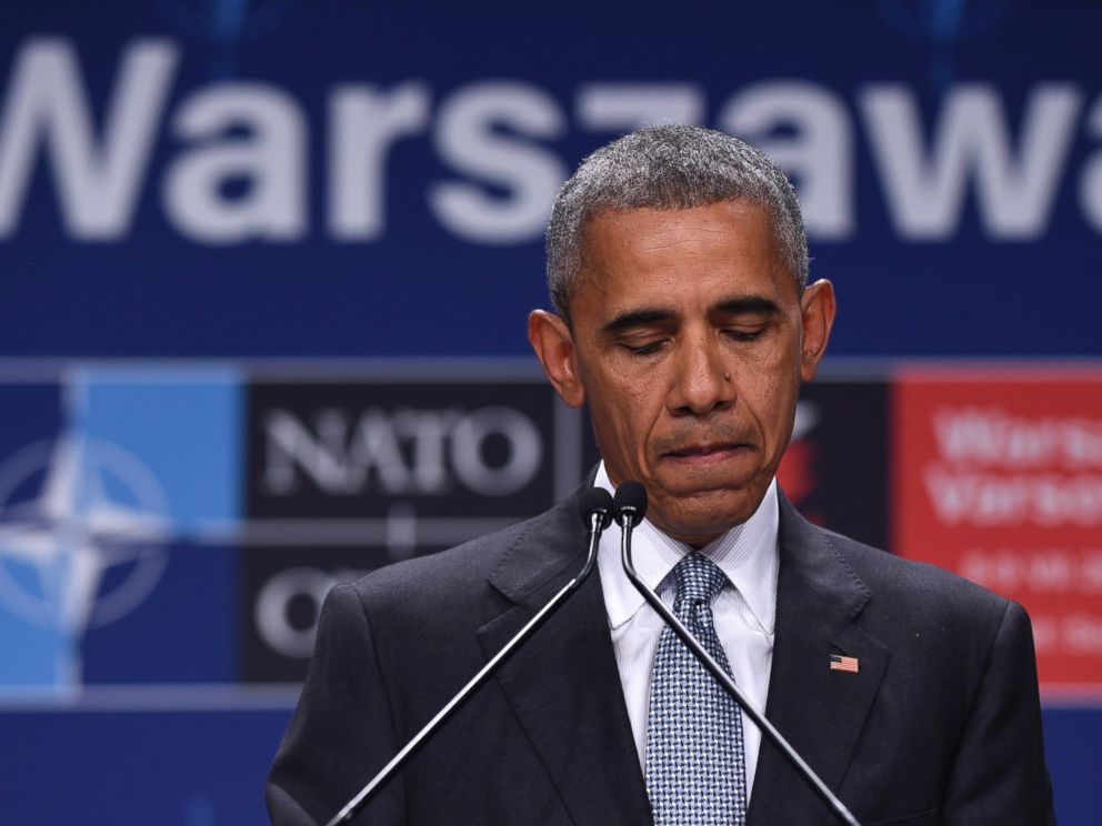 PHOTO: President Barack Obama pauses while speaking about the events in Dallas at the beginning of his news conference at PGE National Stadium in Warsaw, Poland, July 9, 2016.