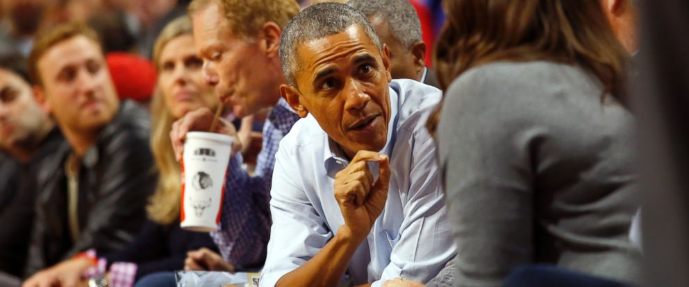 PHOTO: President Barack Obama talks with fans during an NBA basketball game between the Cleveland Cavaliers and the Chicago Bulls in Chicago on Tuesday, Oct. 27, 2015.