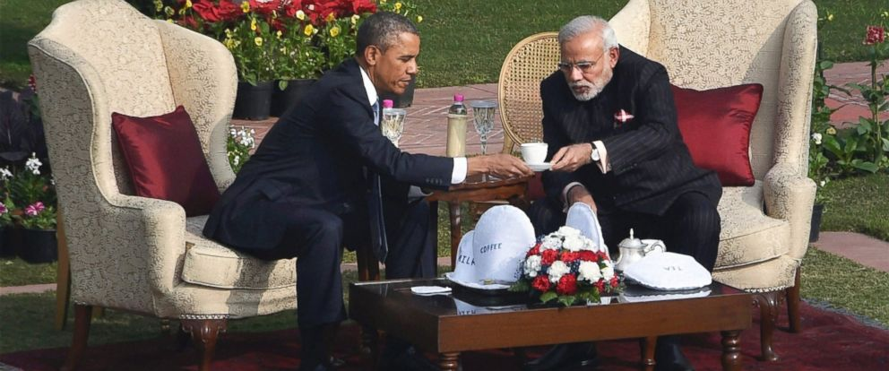 U.S. President Barack Obama, left and Indian Prime Minister Narendra Modi sit down for tea after a stroll in the gardens of Hyderabad House where the leaders held their talks, in New Delhi, India, Sunday, Jan. 25, 2015.