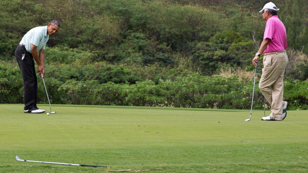 President Barack Obama plays golf with Malaysian Prime Minister Najib Razak, right, Wednesday, Dec. 24, 2014, at Marine Corps Base Hawaii's Kaneohe Klipper Golf Course in Kaneohe, Hawaii during the Obama family vacation.