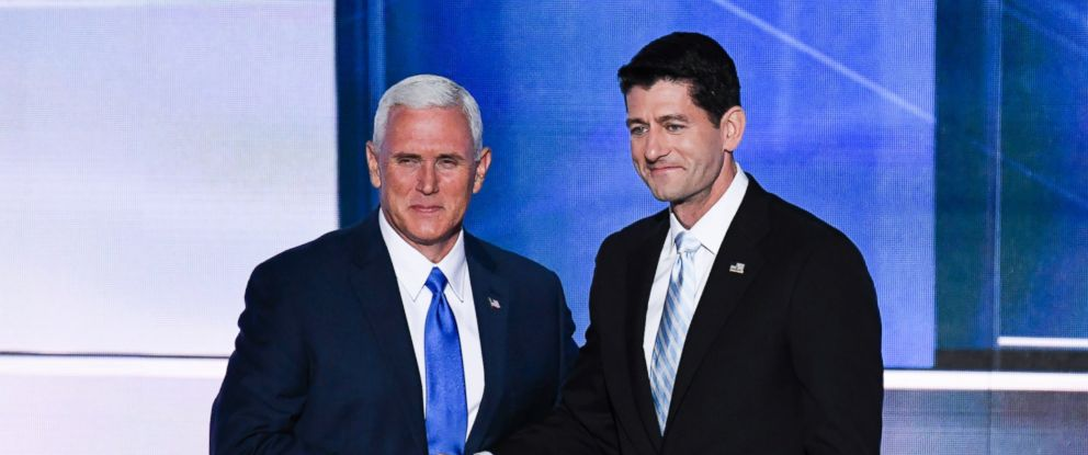 PHOTO: GOP Vice Presidential nominee Indiana Gov. Mike Pence, left, shakes hands with Speaker of the House Paul Ryan (R-WI) as Pence takes the stage to speak at the 2016 Republican National Convention in Cleveland, Ohio, July 20, 2016.