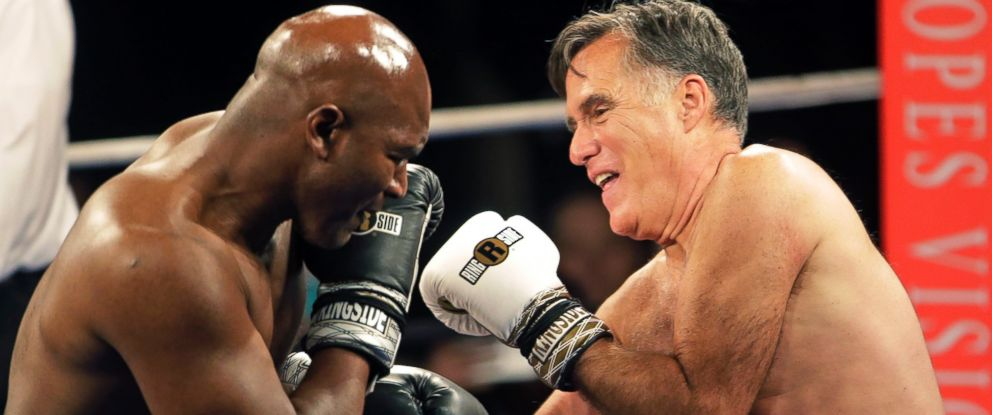 PHOTO: Former Republican presidential candidate Mitt Romney, right, throws punches with five-time heavyweight boxing champion Evander Holyfield at a charity fight night event May 15, 2015, in Salt Lake City.