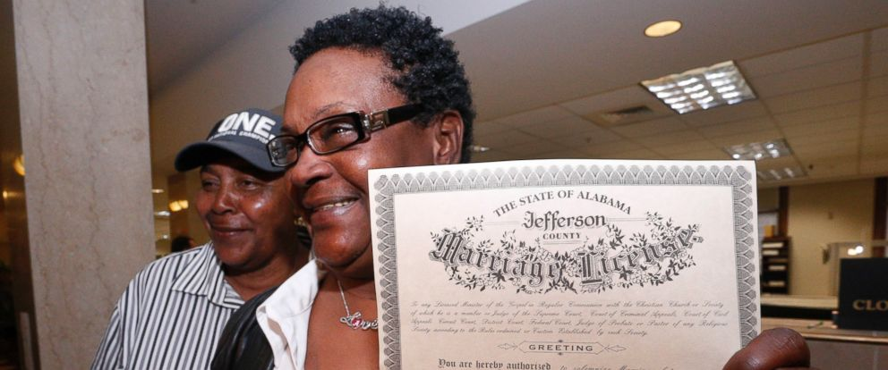 PHOTO: Olanda Smith, left, and Dinah McCaryer show off their certificate after being the first to be married at the Jefferson county courthouse, Monday, Feb. 9, 2015, in Birmingham, Ala.