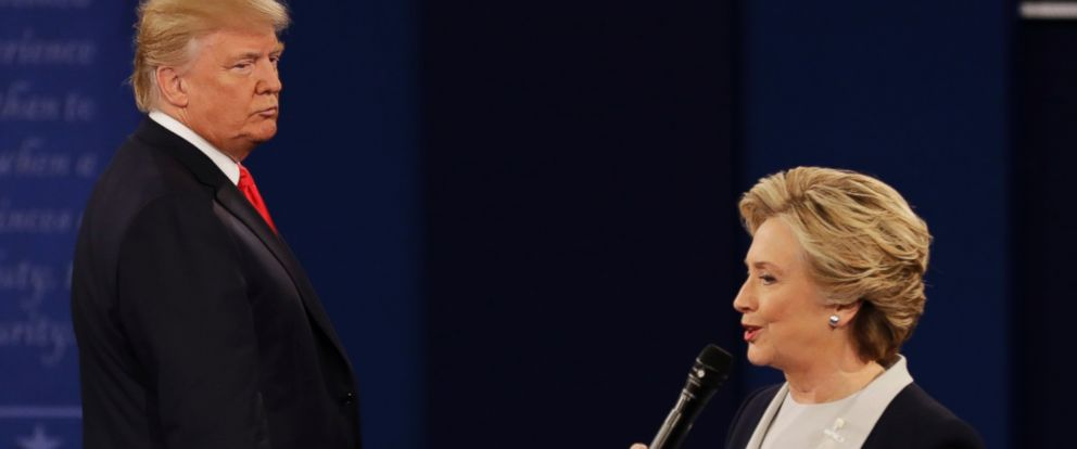 PHOTO: Republican presidential nominee Donald Trump listens to Democratic presidential nominee Hillary Clinton during the second presidential debate at Washington University in St. Louis, Oct. 9, 2016.