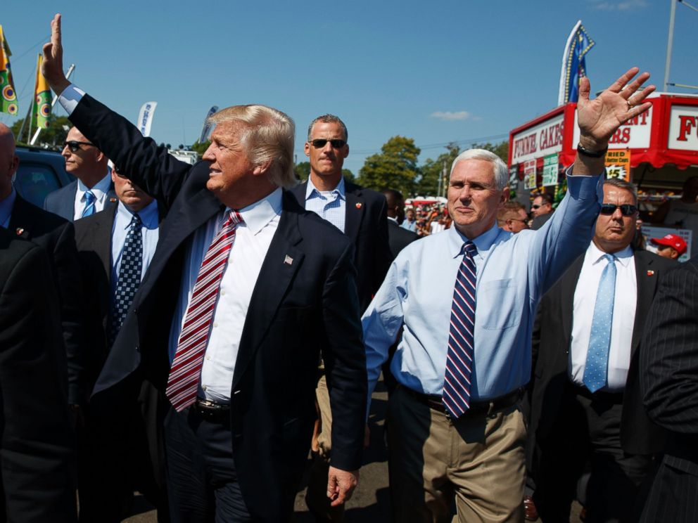 PHOTO:Republican presidential candidate Donald Trump, center left, waves as he walks with vice presidential candidate Gov. Mike Pence, R-Ind., center right, during a visit to the Canfield Fair, Sept. 5, 2016, in Canfield, Ohio.