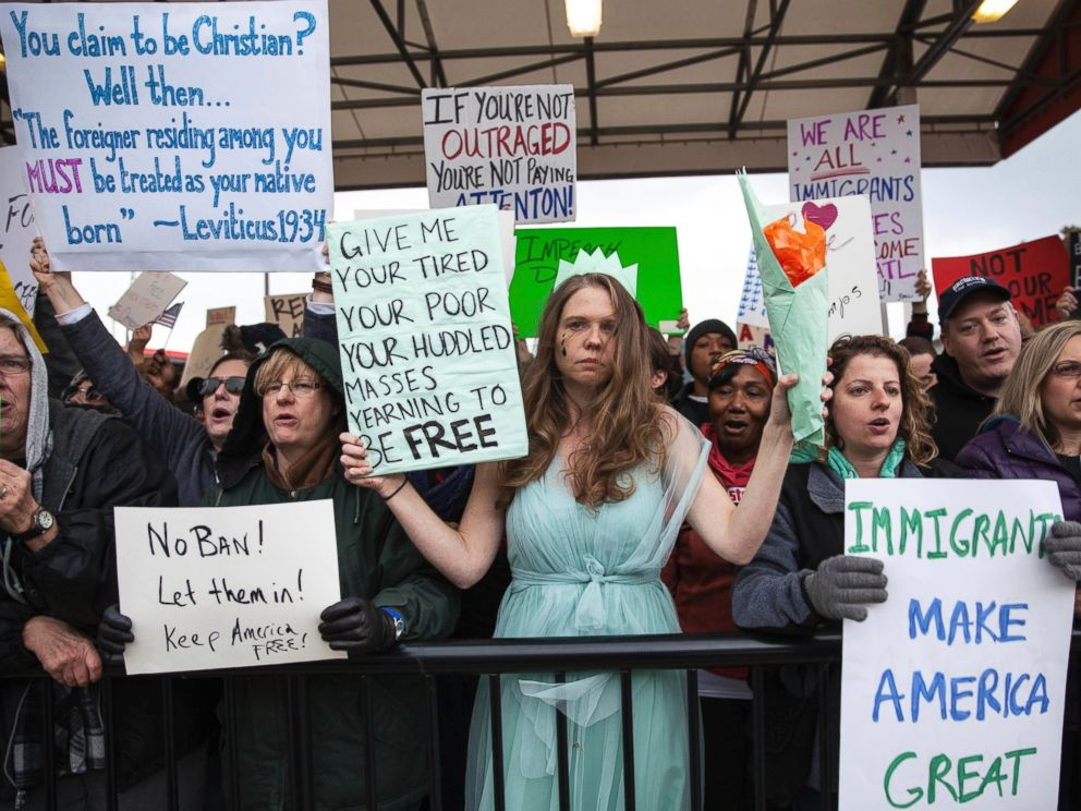 PHOTO: Demonstrators hold signs at Atlanta airport during a demonstration to denounce President Donald Trumps executive order that bars citizens of seven predominantly Muslim-majority countries from entering the U.S., Sunday, Jan. 29, 2017.