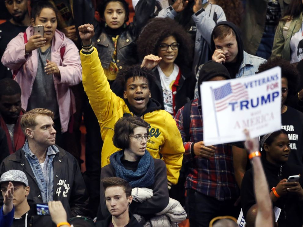 PHOTO: A protester raises his fist to supporters of Republican presidential candidate Donald Trump before a rally on the campus of the University of Illinois-Chicago, March 11, 2016, in Chicago.