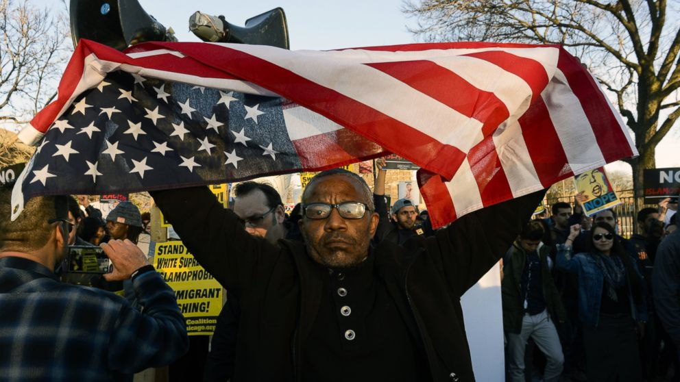 Sanko Hampton marches in Chicago, March 11, 2016, before a rally with Republican presidential candidate Donald Trump at the University of Illinois-Chicago.