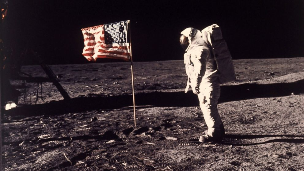 "This July 20, 1969 file photo provided by NASA shows astronaut Edwin E. ""Buzz"" Aldrin Jr. posing for a photograph beside the U.S. flag deployed on the moon during the Apollo 11 mission."