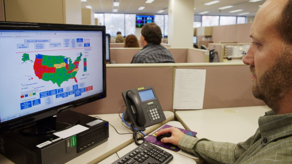 A researcher simulates a check done for the National Instant Criminal Background Check System or NICS, at the FBI's criminal justice center in Bridgeport, W.Va., Nov. 18, 2014.