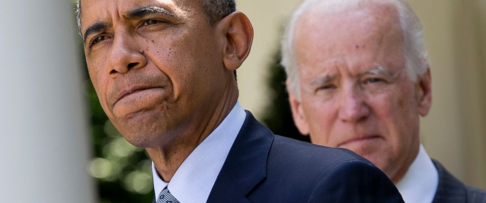 PHOTO: President Barack Obama, accompanied by Vice President Joe Biden, pauses while making an announcement about immigration reform in the Rose Garden of the White House in Washington, June 30, 2014.
