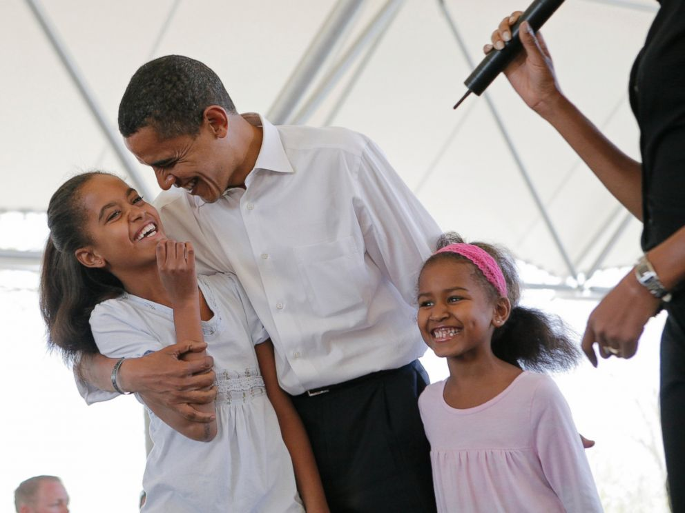 PHOTO: Then-Democratic presidential hopeful, Sen. Barack Obama, D-Ill., stands with his two daughters, Malia, left, and Sasha, as he is introduced by his wife Michelle, right, at Headwaters Park in Fort Wayne, Ind., May 4, 2008.