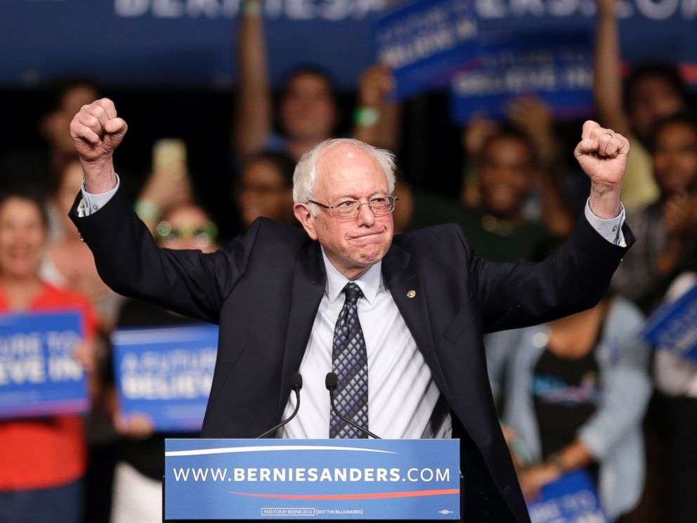 PHOTO: Democratic presidential candidate, Sen. Bernie Sanders, I-Vt. acknowledges his supporters on arrival at a campaign rally, March 8, 2016, in Miami.