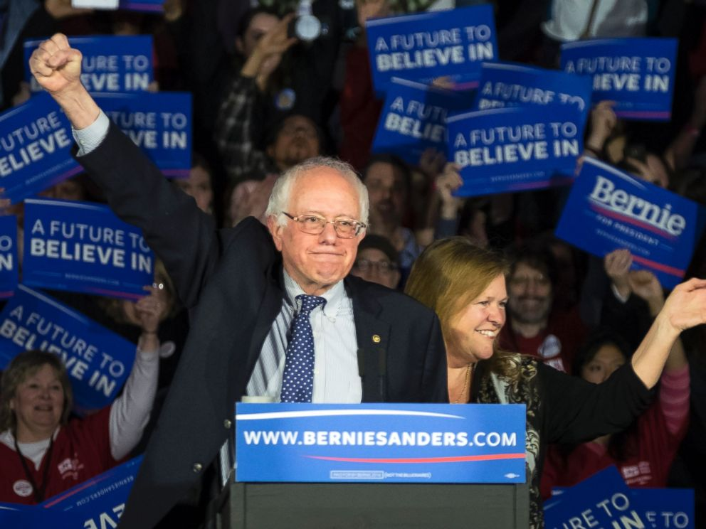PHOTO: Democratic presidential candidate, Sen. Bernie Sanders, and his wife Jane acknowledge the crowd as he arrives for his caucus night rally in Des Moines, Iowa, Feb. 2, 2016.