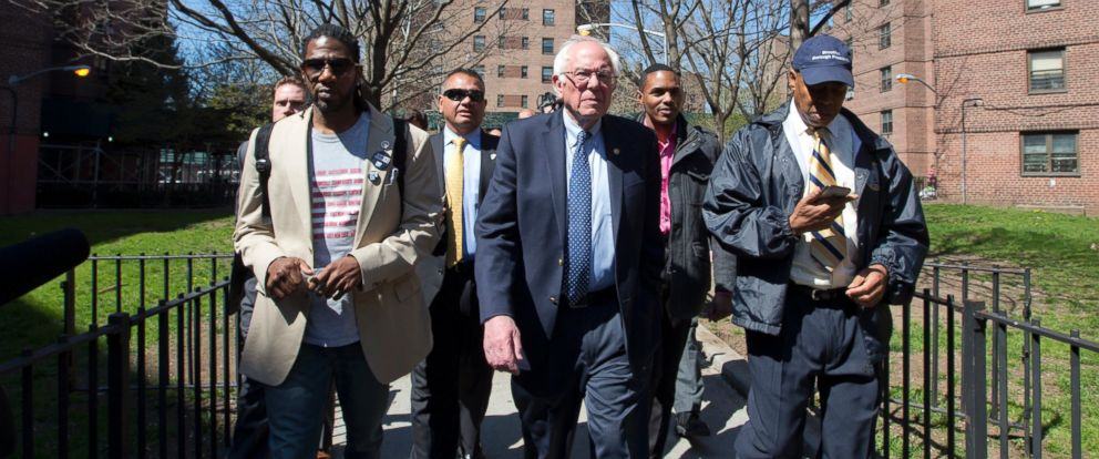 Democratic presidential candidate Bernie Sanders, tours the Howard Houses in the Brownsville neighborhood of the Brooklyn borough of New York with councilman Jumaane Williams, left, and Brooklyn Borough President Eric Adams, April 17, 2016.