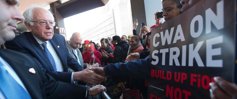 PHOTO: Democratic presidential candidate, Sen. Bernie Sanders, I-Vt., greets a CWA worker at a Verizon workers picket line, April 13, 2016, Brooklyn, New York.