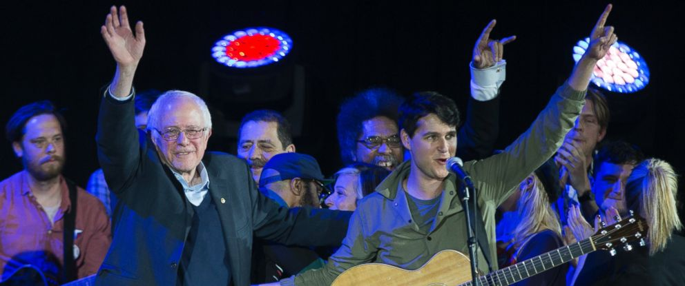 PHOTO: Democratic presidential candidate Sen. Bernie Sanders, I-Vt., left, and Vampire Weekend lead singer Ezra Koenig wave during a campaign rally at the University of Iowa, Jan. 30, 2016, in Iowa City, Iowa.