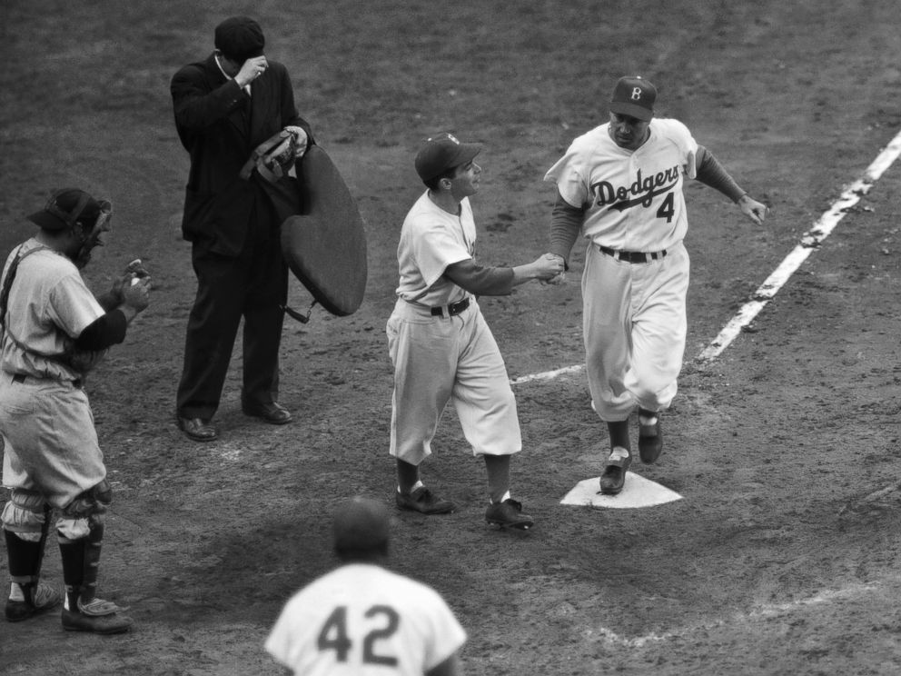 PHOTO: Brooklyn Dodgers Duke Snider is greeted by the batboy on his second homer of Game 6 of baseballs World Series against the New York Yankees at Ebbets Field in Brooklyn, New York, Oct. 6, 1952.