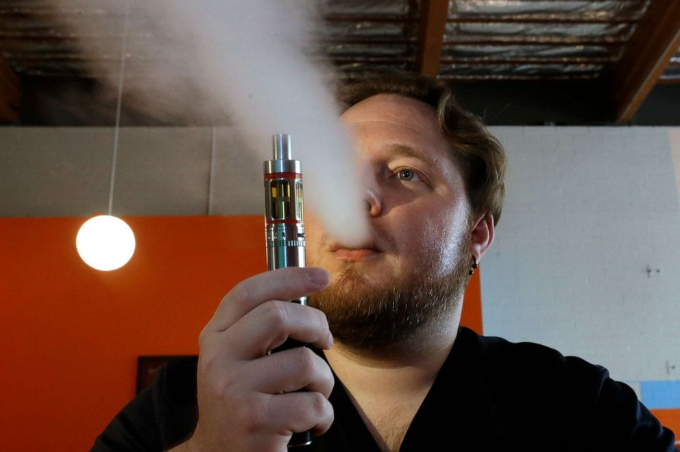 PHOTO: In this July 16, 2015 file photo, Bruce Schillin exhales vapor from an e-cigarette at the Vapor Spot, in Sacramento, California.