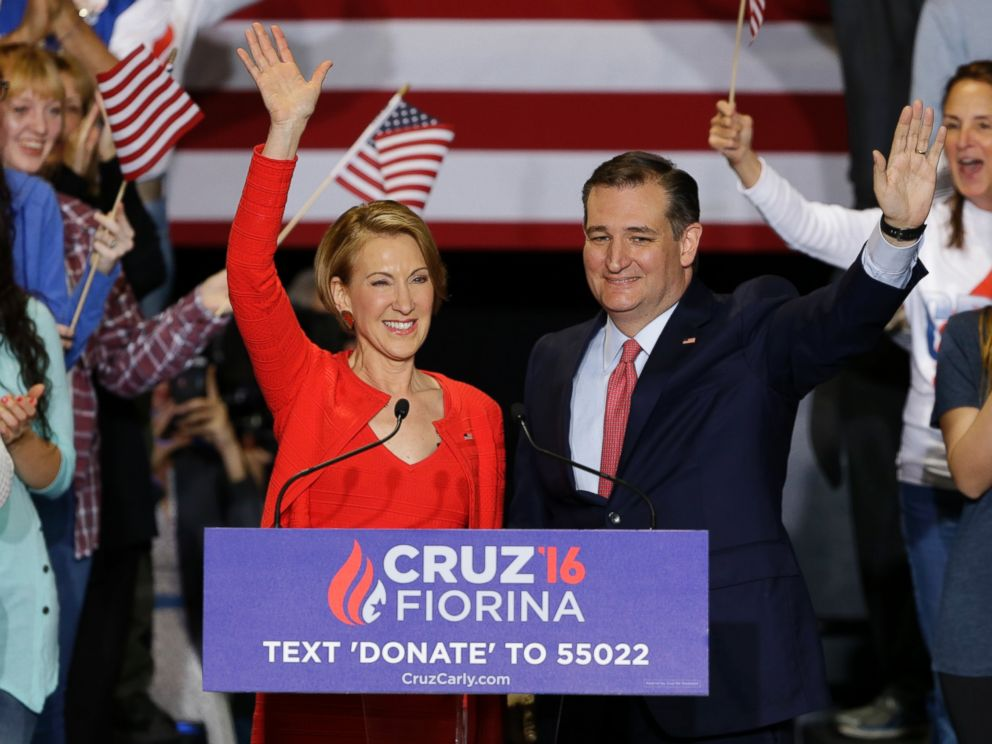 Republican presidential candidate Sen. Ted Cruz, R-Texas, joined by former Hewlett-Packard CEO Carly Fiorina waves during a rally in Indianapolis, April 27, 2016, after Cruz announced he had tapped Fiorina to serve as his running mate.