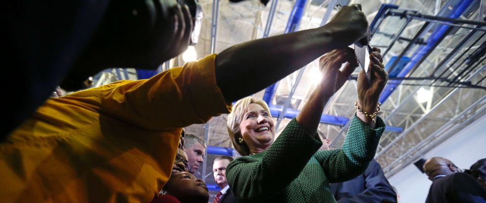 PHOTO: Democratic presidential candidate Hillary Clinton poses for photos with audience members after speaking at a campaign event at Morris College in Sumter, S.C., Feb. 24, 2016.