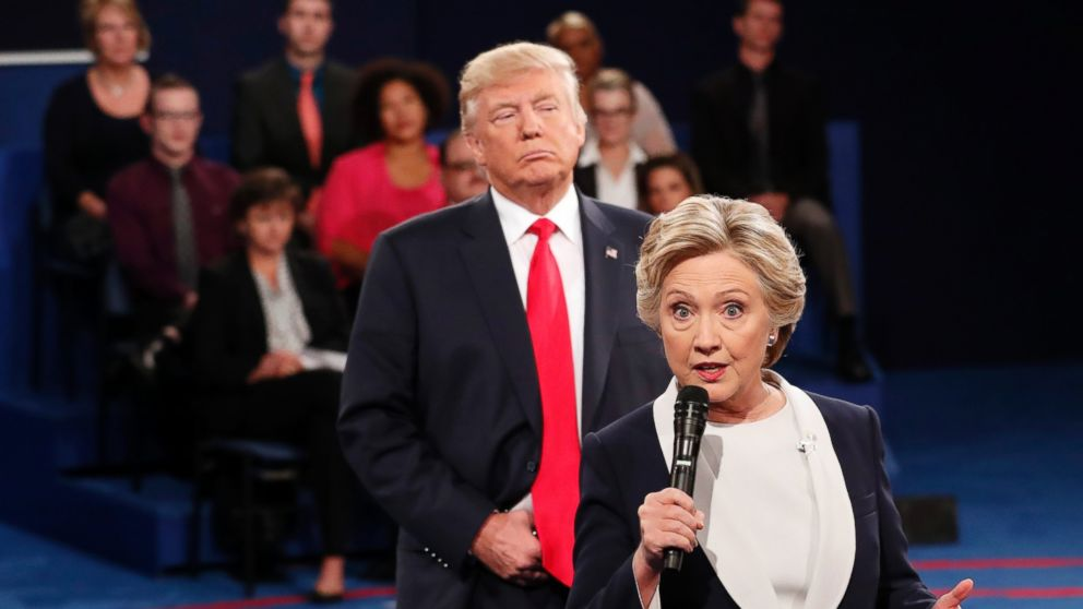 Democratic presidential nominee Hillary Clinton speaks as Republican presidential nominee Donald Trump listens during the second presidential debate at Washington University in St. Louis, Oct. 9, 2016.