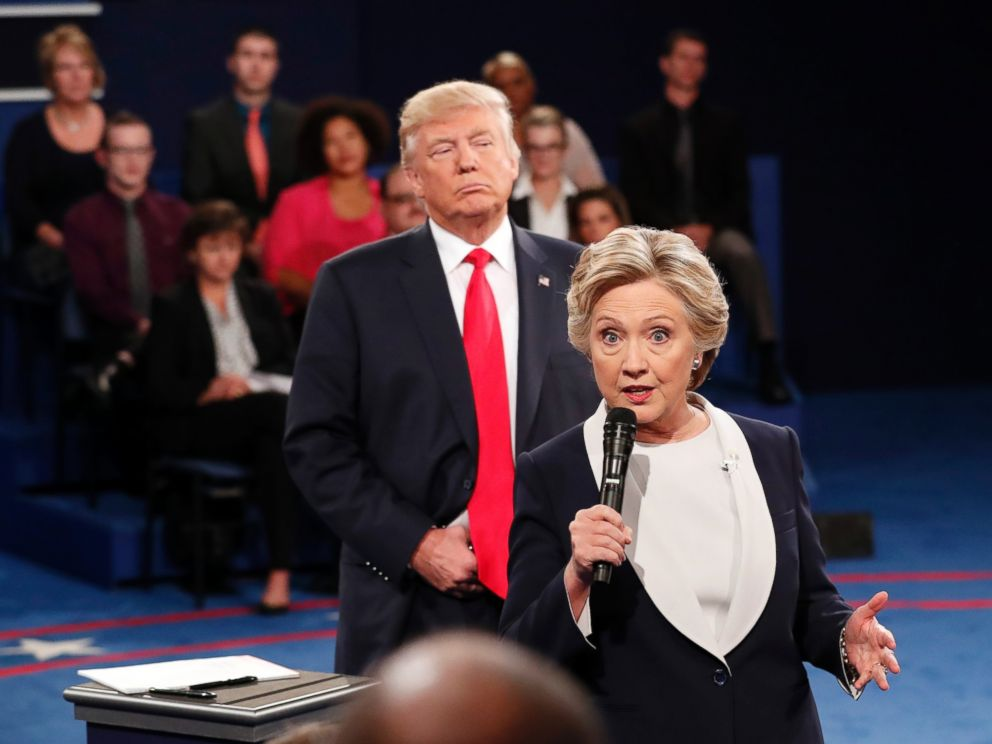 PHOTO: Democratic presidential nominee Hillary Clinton speaks as Republican presidential nominee Donald Trump listens during the second presidential debate at Washington University in St. Louis, Oct. 9, 2016.