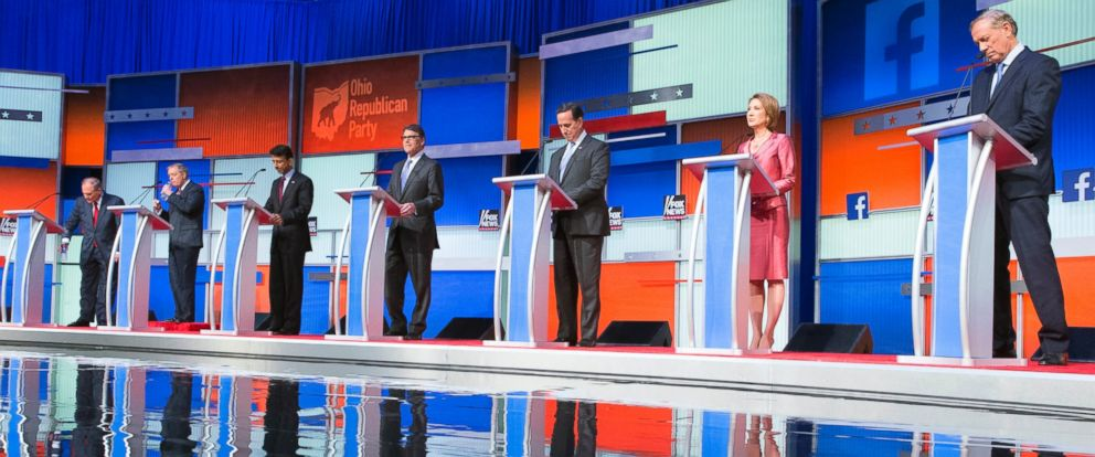 PHOTO: Republican presidential candidates from left, Jim Gilmore, Lindsey Graham, Bobby Jindal, Rick Perry, Rick Santorum, Carly Fiorina, and George Pataki participate in a pre-debate forum at the Quicken Loans Arena, Aug. 6, 2015, in Cleveland.