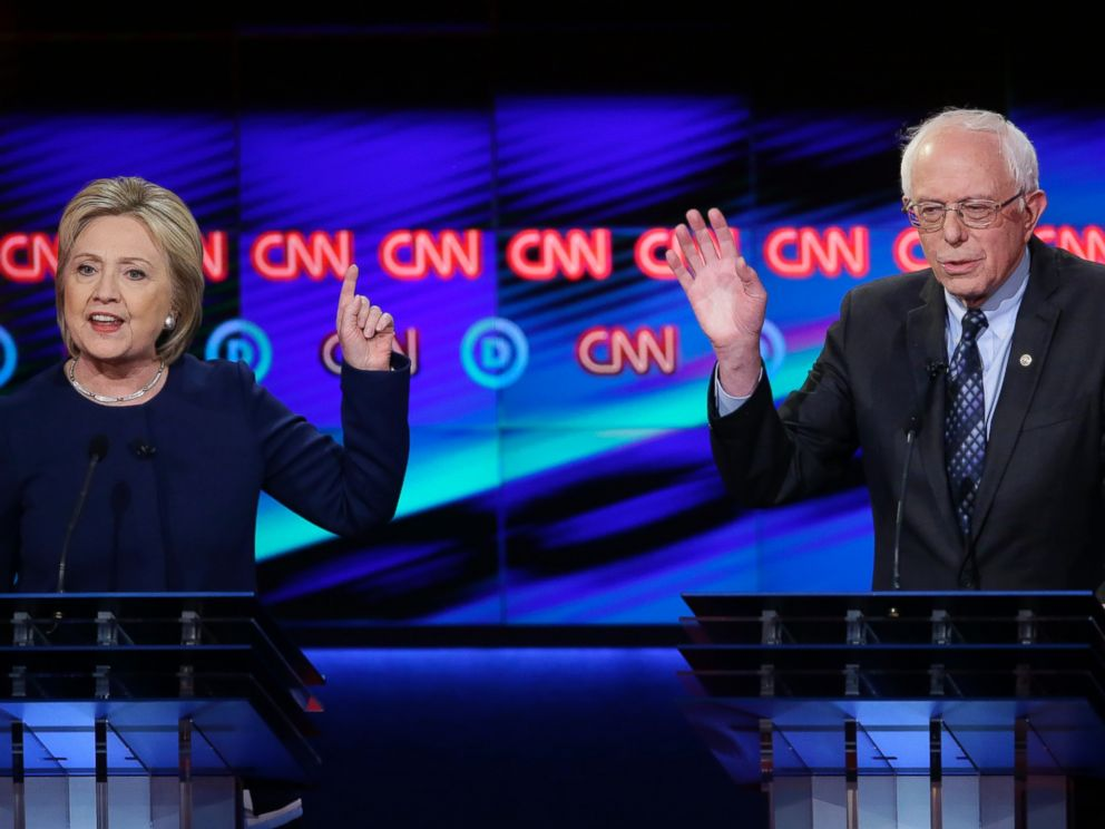 PHOTO: Democratic presidential candidate, Hillary Clinton argues a point as Sen. Bernie Sanders, reacts during a Democratic presidential primary debate at the University of Michigan-Flint, March 6, 2016, in Flint, Mich.