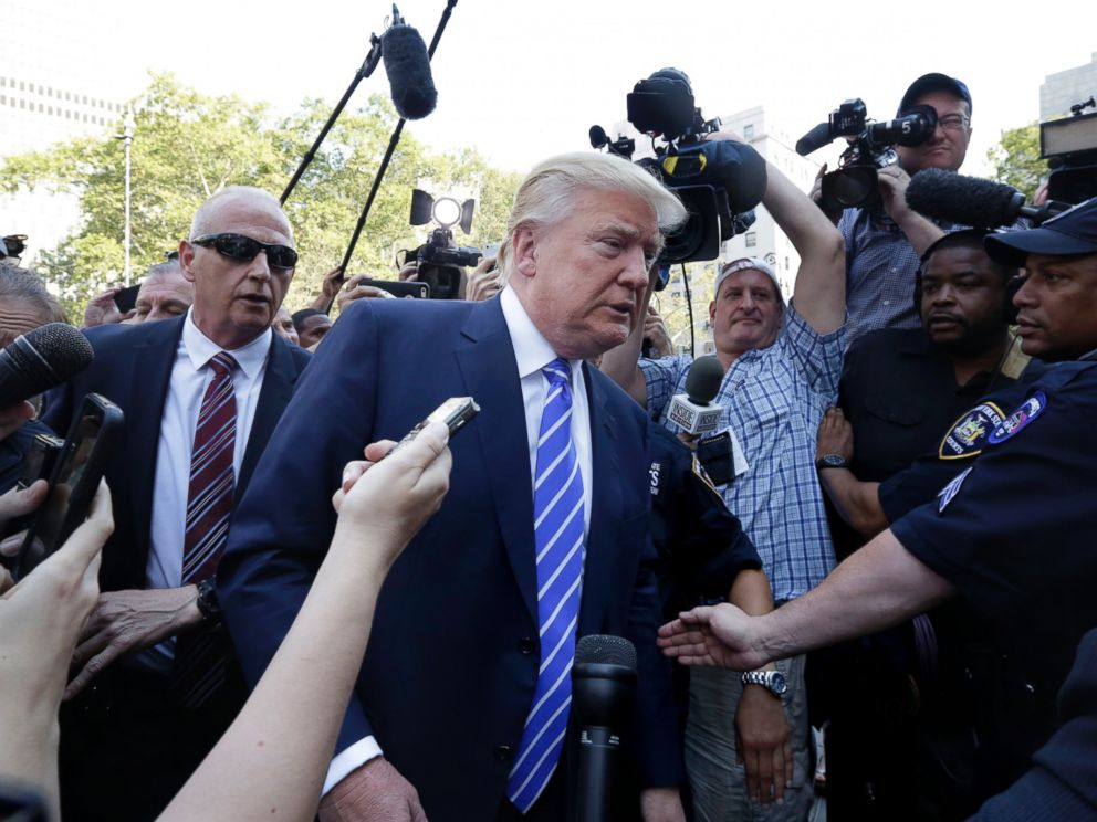 PHOTO: Republican presidential candidate Donald Trump is surrounded by media as he arrives for jury duty in New York, Aug. 17, 2015.